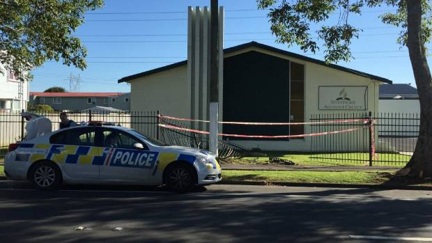 A large hole was left in the fence outside the Seventh-day Adventist Church in Otara after the police chase.