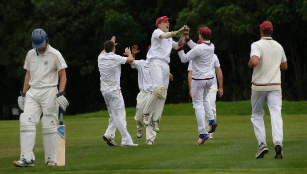 Upper Hutt players on a celebration high after taking another wicket in Pearce Cup cricket at Trentham Memorial Park on ...