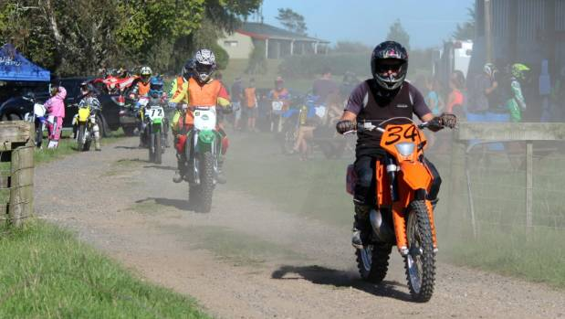 Riders kick up dust as they leave the parking area.