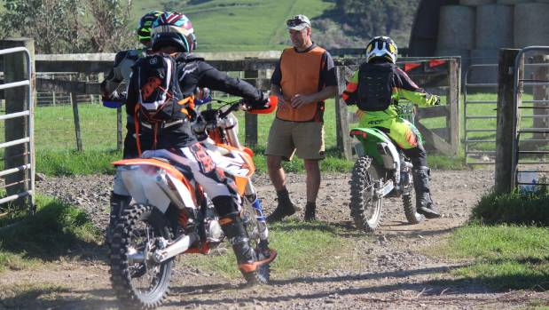 Hikutaia School marshal Dave Stuart checks riders off at the start of the trail ride.