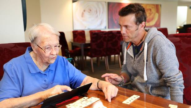 JRR Tolkien's grandson Royd Tolkien plays rummikub with Ernest Rutherford Retirement Village resident Ola Palmer during ...