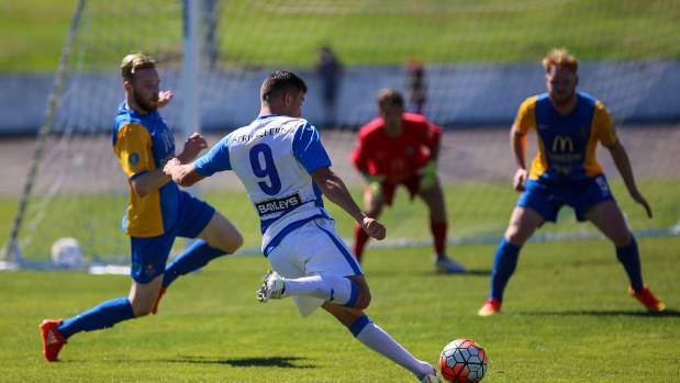Tasman United's Ermal Hajdari tries to shoot despite the attention of Southern United's Ross Howard and Stephen Last ...