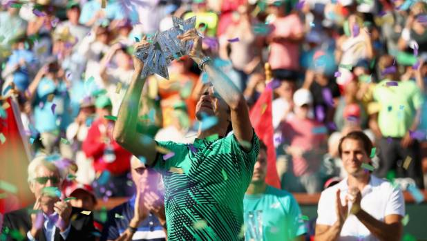 Roger Federer celebrates winning Indian Wells.