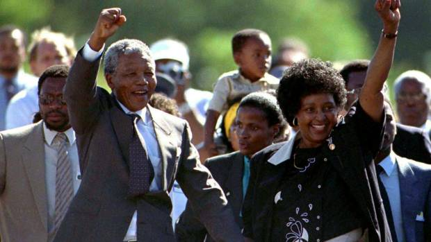 Nelson Mandela, accompanied by his wife Winnie, walks out of the Victor Verster prison near Cape Town, South Africa, on ...