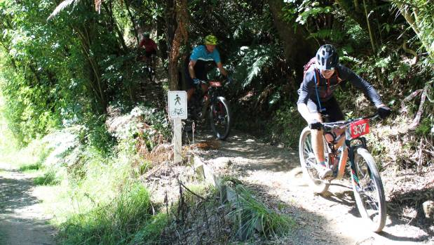 Pete Wells, right, and Blair Francis tear down one of the trails during the Kahuterawa Challenge at Arapuke Forest Park ...