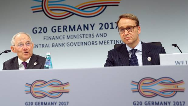 German Bundesbank President Jens Weidmann and German Finance Minister Wolfgang Schaeuble (left) address a news ...
