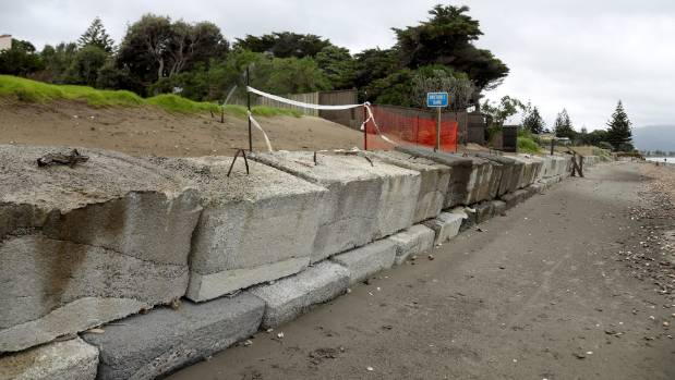 Blocks on a temporary concrete wall along a section of Paraparaumu Beach are getting that sinking feeling.