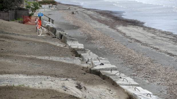 Leaning blocks on the wall along a section of Paraparaumu Beach.