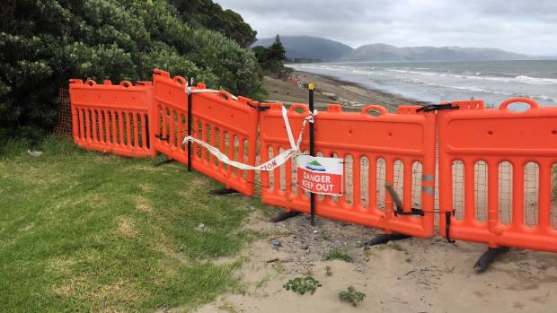 The safety barrier at the top of the concrete block wall at Paraparaumu Beach, near Wharemauku Rd.