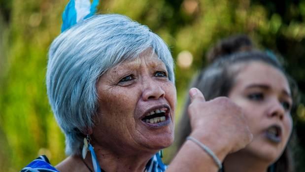 Marie Normile, of Te Rerenga O Te Ra, performs at Omaka Cemetery.