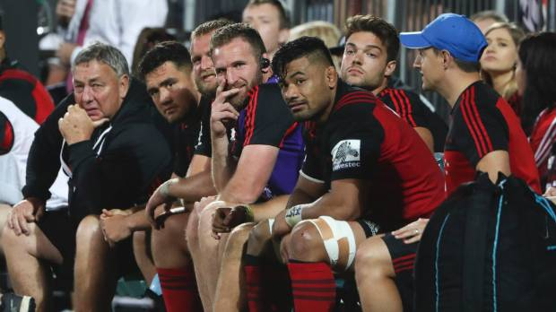 Injured No 8 Kieran Read perches himself on the Crusaders bench during the team's 33-24 win over the Blues in ...