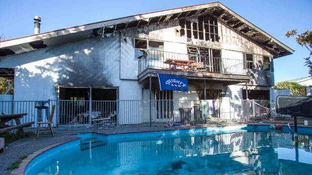 Two men took a leap of faith into their pool as the flames encroached.