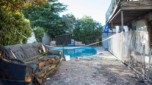The Upper Riccarton house where two men had to jump from the balcony into the pool to escape a fire on Monday morning.