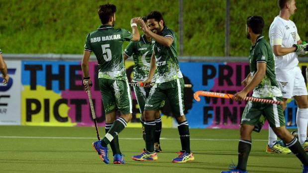 Pakistan's Abu Mahmood celebrates scoring one of his three goals against New Zealand on Monday.