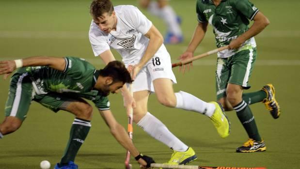 Blacksticks player Cameron Hayde tries to run past the Pakistani defense on Monday night.