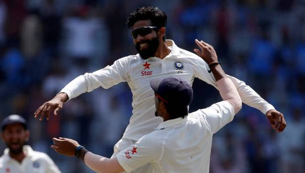 India's Ravindra Jadeja celebrates after bowling Australia's captain Steven Smith.