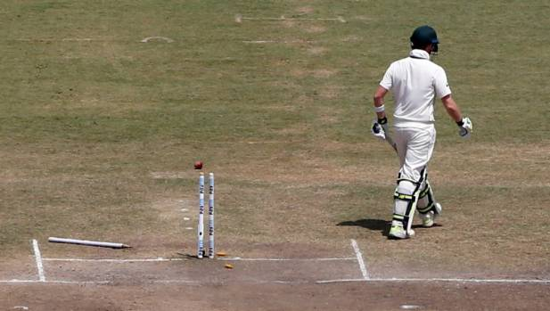 Australia's captain Steven Smith walks off the field after his dismissal.