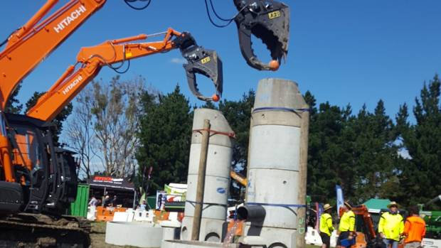 Steve Galbraith (foreground) and Sam Scott dunk a basketball during the Civil Contractors New Zealand (CCNZ) National ...
