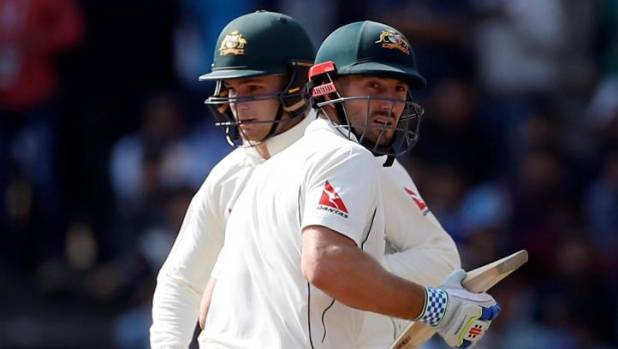 Australia's Peter Handscomb (left) and Shaun Marsh put on 124 runs for the fifth wicket to claim a draw.