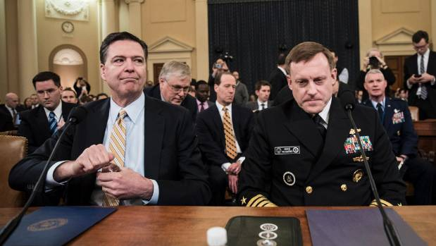 FBI Director James Comey (left) and Michael Rogers, Director of the NSA, arrive for a House Permanent Select Committee ...