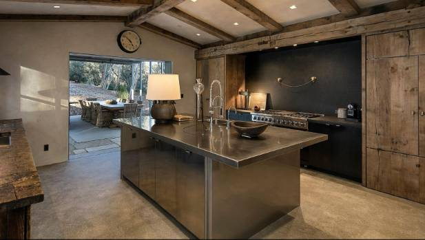 The stunning kitchen teams modern materials with old timbers.