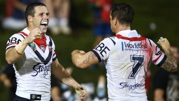 Roosters fullback Michael Gordon, left, celebrates scoring a try with teammate Mitchell Pearce against the Panthers.