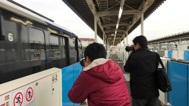 "Muneki Watanabe and Katsuhiko Orido, both ""tori-tetsu,"" take pictures of the Tokyo monorail, which runs from central ..."