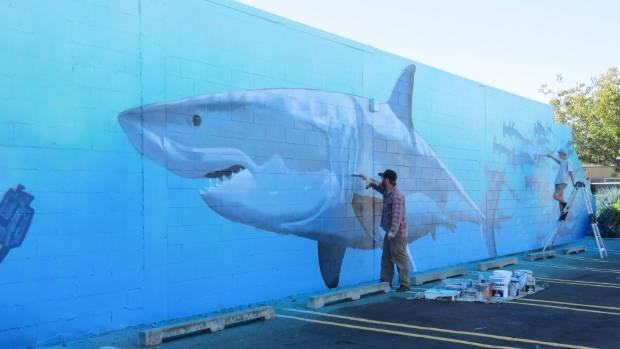Freeman White and John Berryman working on White's Sea Walls mural.