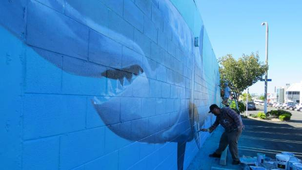 Freeman White and John Berryman working on White's Sea Walls mural.