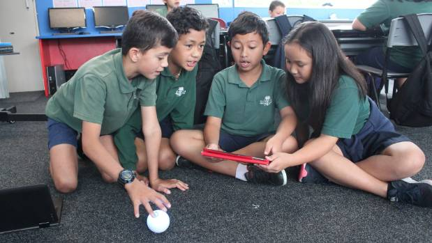 Glenfield Primary School pupils Nikau Hepi, 10, Darius Hanipale, 10, Arzu Bali, 9 and Shaine Bondad, 9, use tablets and ...
