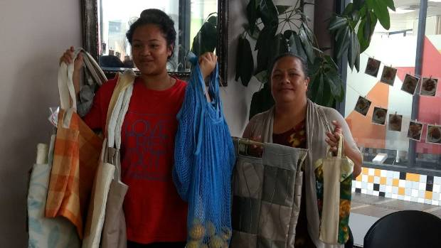 O'Love Uluave, left, and Folola Finau from Multi Education Support Services Trust show their  support for reusable ...
