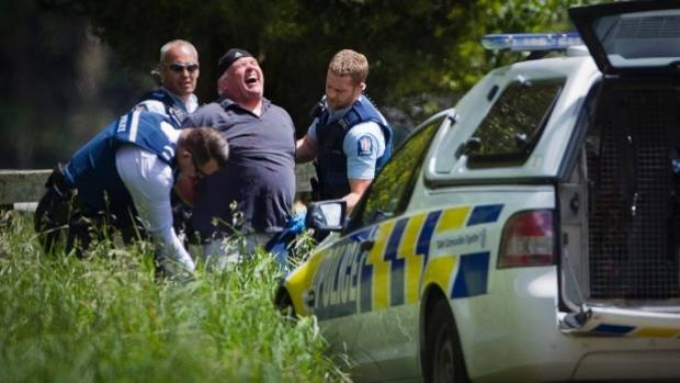 Police catch John Fagan when he went on the run from a prison work gang in 2014.