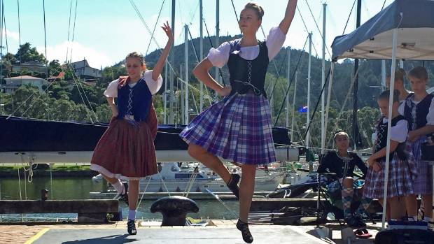 Lauren Beare and Shannon Vesey dance at the town basin.