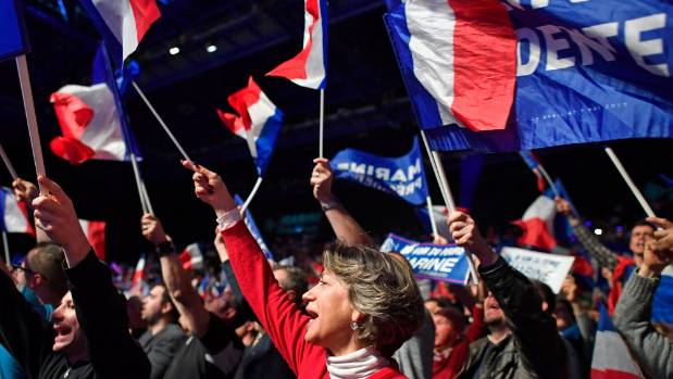 Far right supporters attend a presidential campaign rally by National Front Leader Marine Le Pen. Her father, Jean-Marie ...