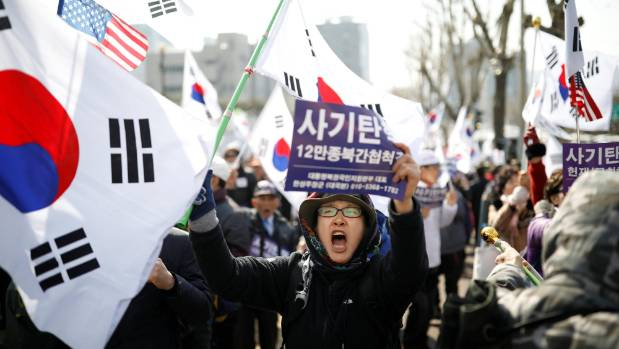 Supporters of South Korea's ousted leader Park Geun-hye attend a rally in front of a prosecutor's office in Seoul.