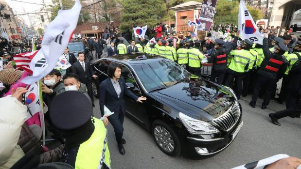 A car carrying Park Geun-hye leaves from her private home in Seoul on Tuesday March 21.