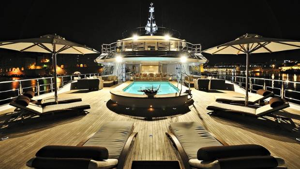 The deck of Vibrant Curiosity reveals the luxurious lounging area and swimming pool.