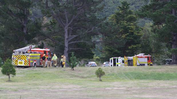 Emergency services at Rarangi Golf Club on Tuesday after a man was trapped by an overturned tractor.