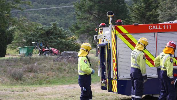 Firefighters and ambulance staff helped rescue a man trapped by a tractor at Rarangi Golf Club.