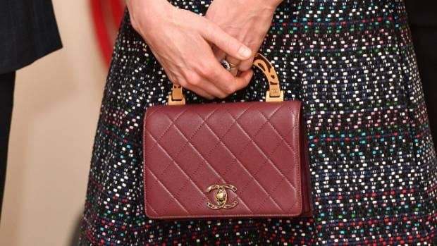 A close-up of the burgundy Chanel handbag.
