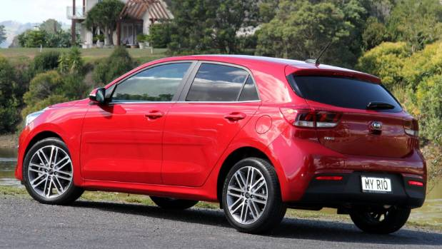 Top $27k LTD has machine-finish alloy wheels, privacy glass, pseudo-leather upholstery/dash trim.