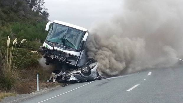 The crash site near Te Anau, before the two vehicles were engulfed in flames.