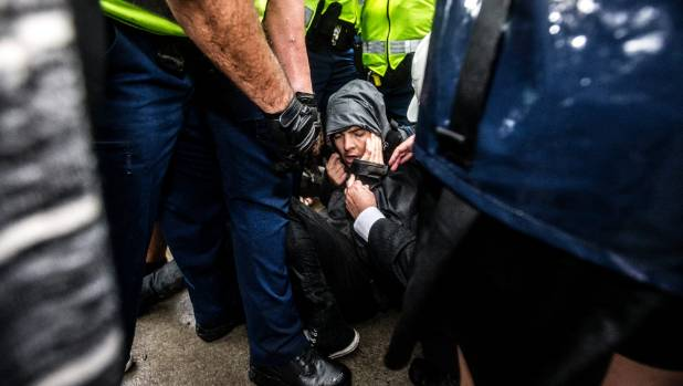 Protesters tried to resist police who had to physically remove the coalition members as they blocked entrances to the ...