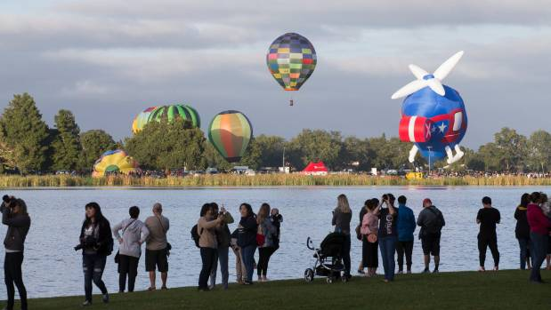 Spectators watched the balloons rise from around Lake Rotoroa, Hamilton, on Wednesday morning at the mass ascension for ...