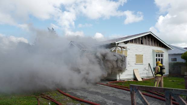 Firefighters burn down a Palmerston North house during the filming of Escape My House.