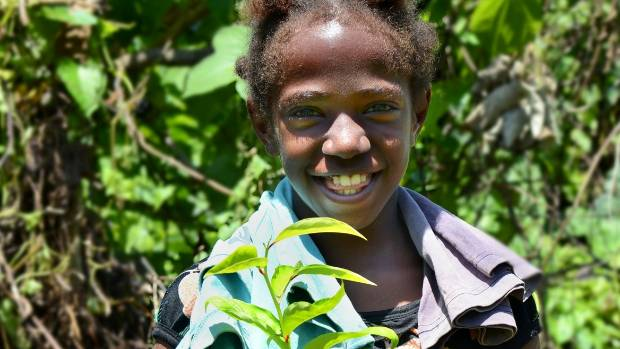 A local girl during a planting day at Ekos' Vanuatu Project.