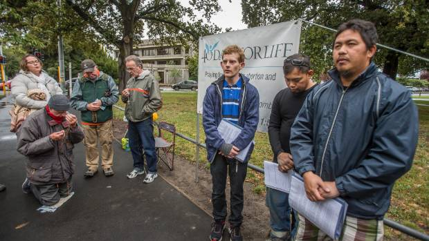 Anti-abortion protesters hold a vigil near Christchurch Hospital in 2016.