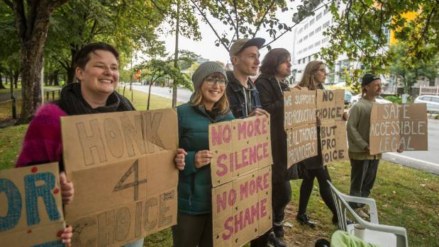Pro-choice advocates at a counter protest, at the same time as pro-life protesters were holding a vigil near ...