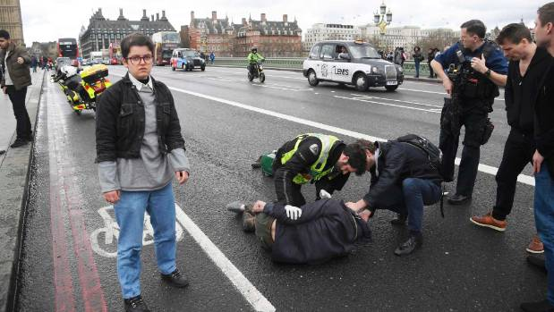 Injured people are assisted after an incident on Westminster Bridge in London.