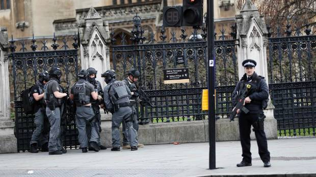 Armed police respond outside UK Parliament during an incident on Westminster Bridge in London.